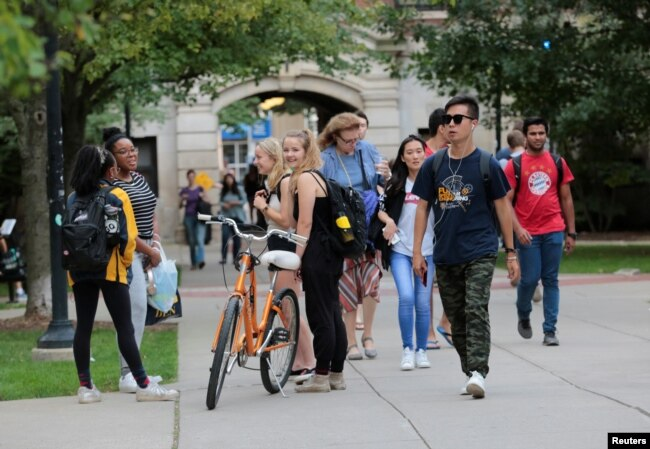 Students walk on campus at the University of Michigan in Ann Arbor, Michigan, Sept. 19, 2018.