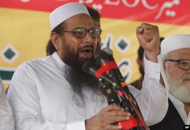 FILE - Hafiz Saeed, leader of Jamaat-ud-Dawa, addresses an anti-Indian rally in Lahore, Pakistan, Sept. 30, 2016.
