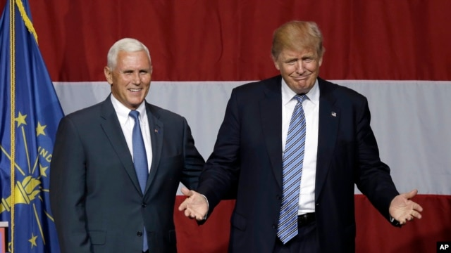Indiana Gov. Mike Pence joins Republican presidential candidate Donald Trump at a rally in Westfield, Ind., July 12, 2016.