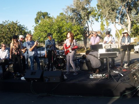 Band with Dr. Kathy playing Guitar