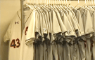 The newly washed Auburn Baseball jerseys line the wall in anticipation of opening day.