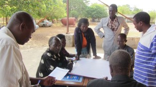 Participants complete their community mapping exercise with community leaders. Zambia gold client