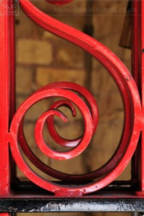 weekly photo project - red curly railings