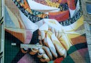 "A close-up of a section of Renau's ""The Unity . . ."" mural, here with a motif echoing the ""shaking hands"" emblem of the ruling Socialist Unity Party"