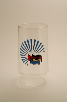 A water glass with the flags of the GDR, Soviet Union and the GDR's youth organization, the Free German Youth (photo: R. Newson).