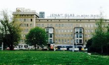 """""""Jena Glass Around the World"""", 80s-era ad atop an apartment block on the southern end of the ring road around central Leipzig, 1999 (photo: author)."""