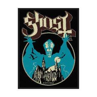 OPus Eponymous patch image - a gothic cathedral has a pale blue Papa Emeritus I looming over it with arms outstretched menacingly.