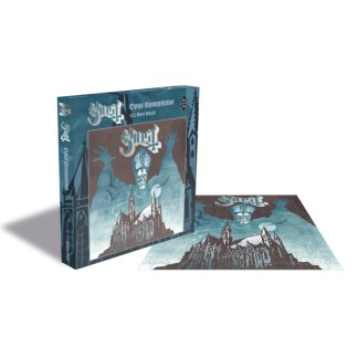 Ghost Opus Eponymous 500 Piece Jigsaw Puzzle - the image shows the completed jigsaw puzzle lying flat while the box is standing upright. The image itself on the jigsaw is a mix of shades of blue with Papa Emeritus making up the moonlit sky with his arms raised in a menacing pose, behind a Gothic building which is outlined against the sky.
