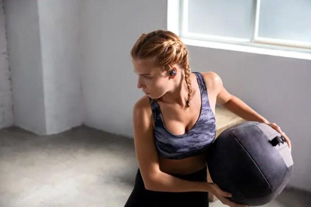woman working out using Soundcore Spirit Dot 2 wireless earbud headphones