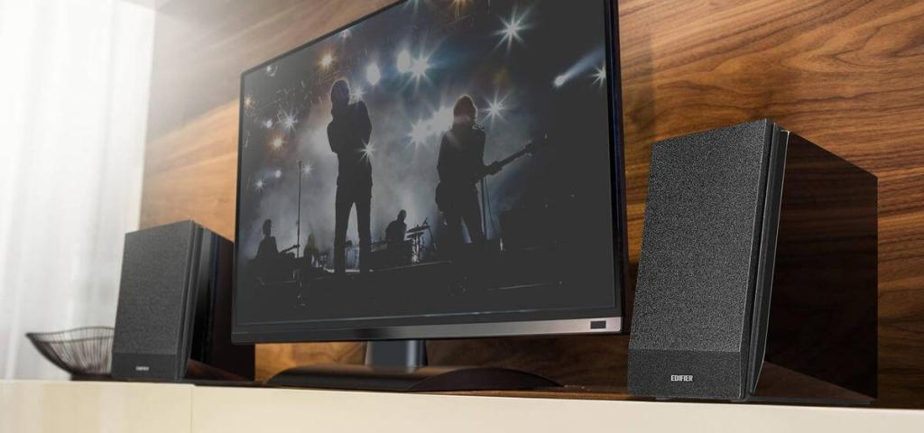 Edifier's R1850DB bookshelf speakers on a shelf on either side of the television set.