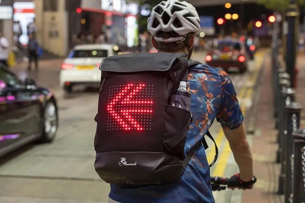 A man riding his bike while wearing his RoadwareZ backpack.