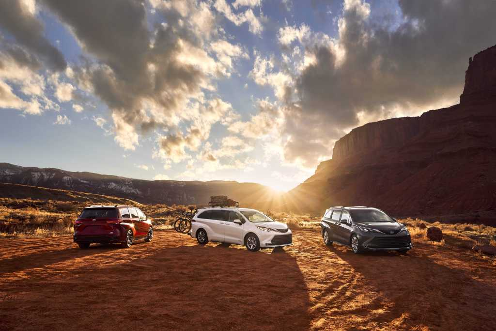Three Toyota Siennas out in an Arizona desert during a beautiful sunset.