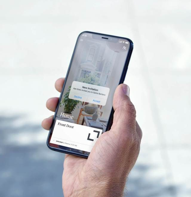 The Level Bolt app being used on a phone with an invitation to let a person in the house.