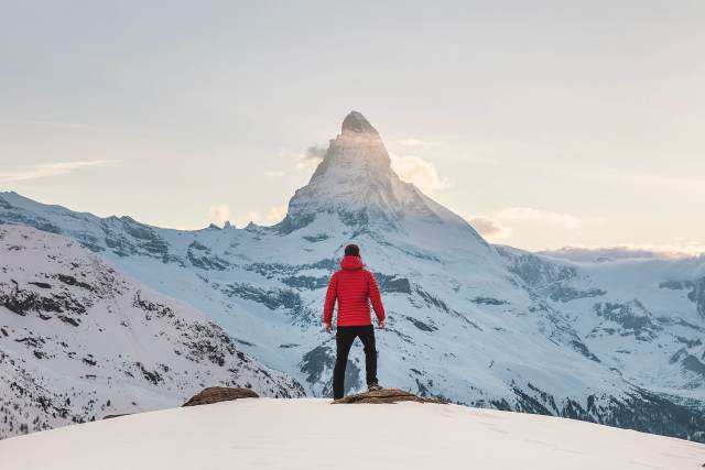 A man standing on a mountain.