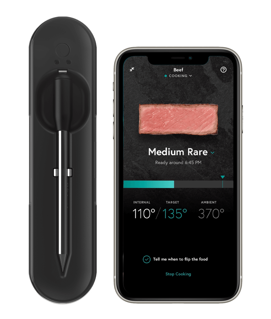 The Yummly Smart Thermometer on display alone with the app on a phone.