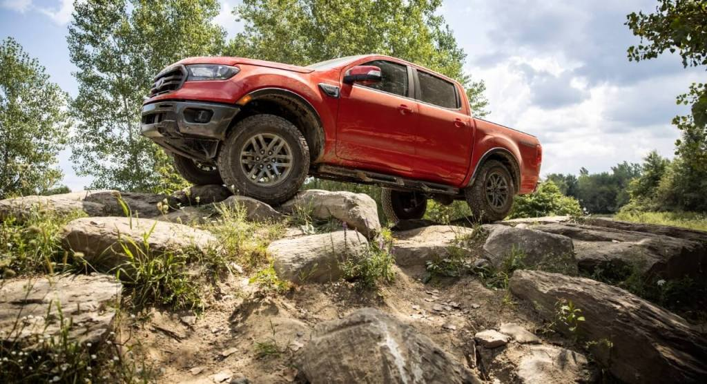 The 2021 Ford Ranger scaling a pile of boulders.