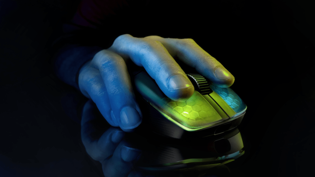 Someone using their One Pro Air gaming mouse from Roccat while it lights up a beautiful green and blue with its RGB lighting.