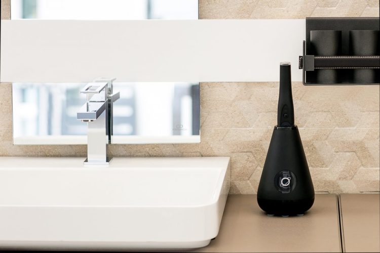 Aura-Clean-System-Toothbrush-&-Cleaning-Brush-Black-Lifestyle-Background-v3-web