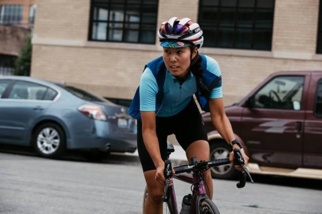 Strava Subscription; woman riding a bike