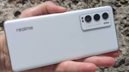The back of the realme GT Master Edition in White showing the rear camera array