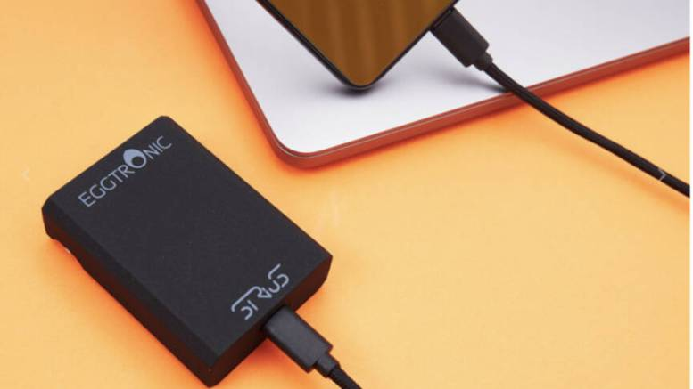 The Eggtronic Sirius 65W Universal Charger charging a phone