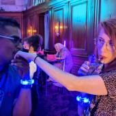 A man dramatically kisses his female friend's hand as he says hi.