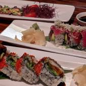 Three plats of sushi.