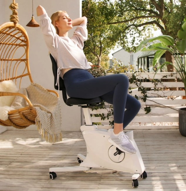 Woman sitting on the Flexispot Sit2Go 2-in-1 Fitness Chair