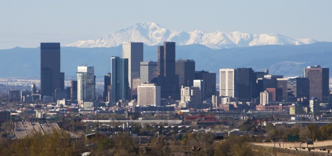 The Colorado State capitol dome in real Colorado gold gilding stands on the left in this skyline shot of downtown with the distant Pike's Peak mountain looming in the background in Denver on April 30, 2011.     UPI/Gary C. Caskey