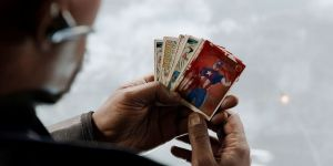 Nick Fury holds Coulson's trading cards
