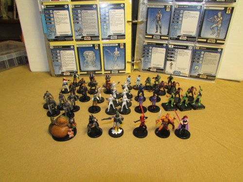 Sorted Star Wars Miniatures with stat cards