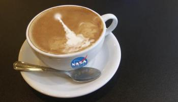 NASA coffee cup with a space launch in the foam