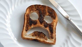 A piece of toast with an unhappy face carved into it - how to defeat monday mornings