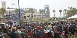 The crowd at Comic-Con spills out of the Convention Center toward Petco Park and the Gaslamp District. Photo by Rick R. 1. Used under a Creative Commons license.