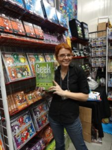Rebekah Zetty of Playroom Entertainment shows off Geek Out, their new geek trivia game.