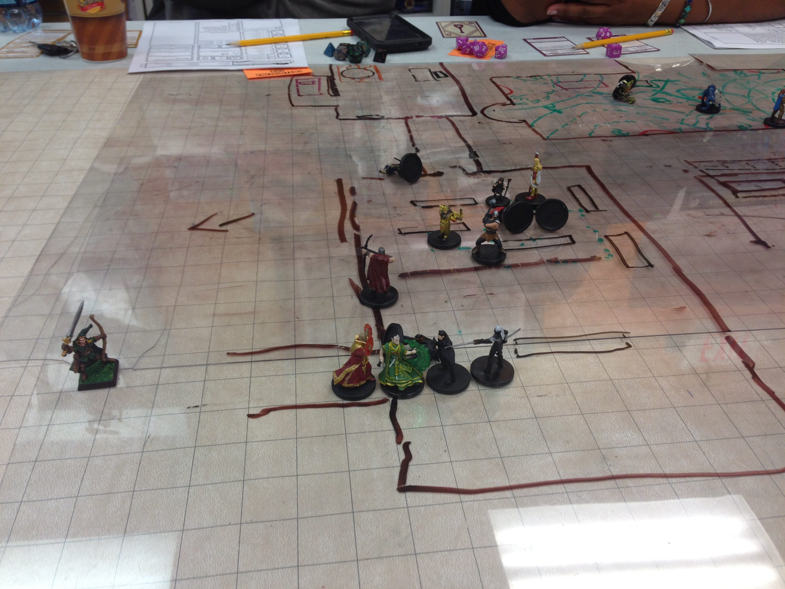Both guards and the female cleric close in. I sleep them, but she wakes one up. Then we take some damage.