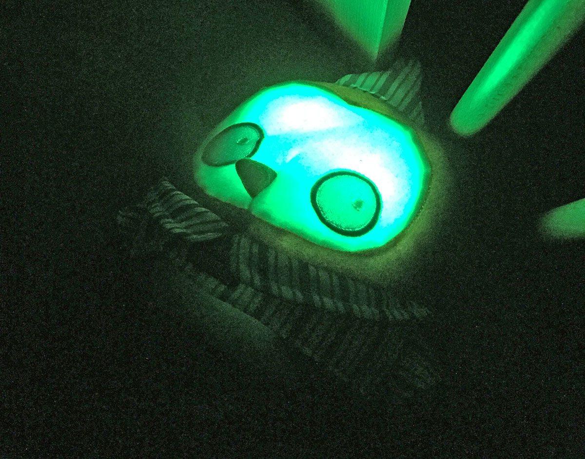 OK to Wake! Owl glows green when it's ok to wake up.