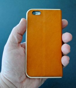 leather and wood add warmth to the iPhone