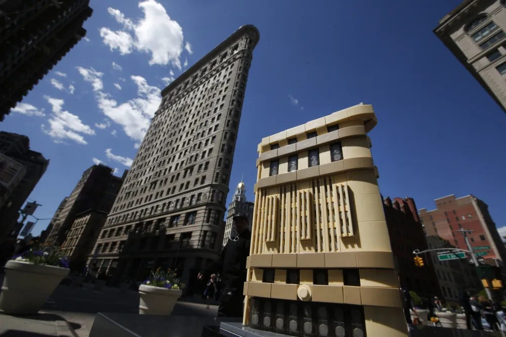 The LEGO Architecture Flatiron set is pictured in front of New York's iconic Flatiron Building, Wednesday, April. 29, 2015, in New York. (Jason DeCrow/AP Images for LEGO Systems)