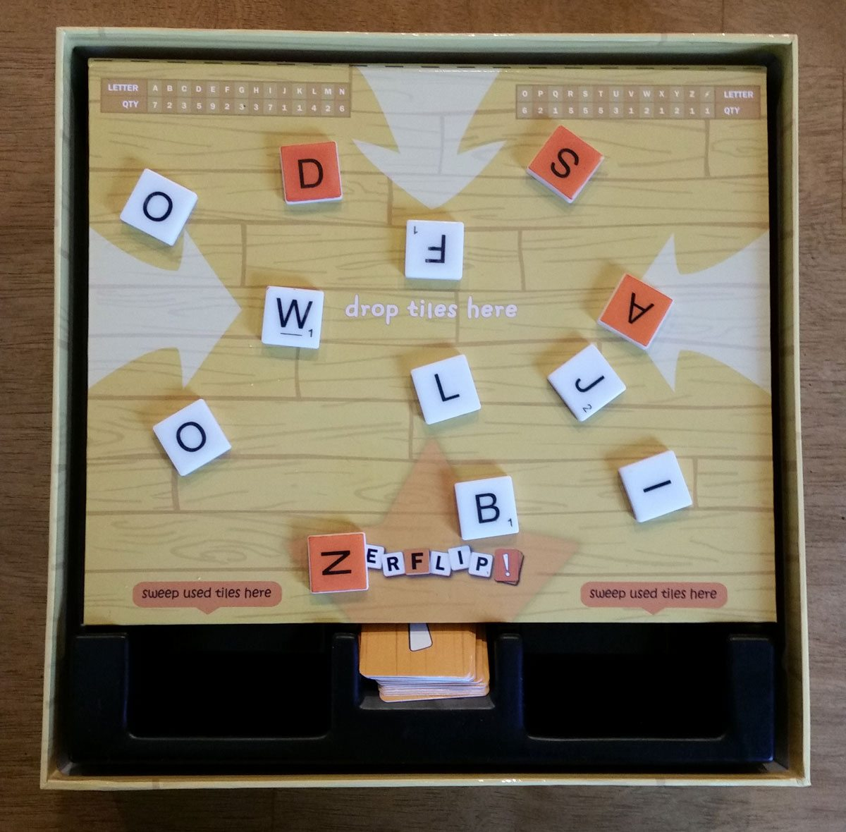 After scoring the word 'sand', orange tiles now worth fewer points. Image by Rob Huddleston.