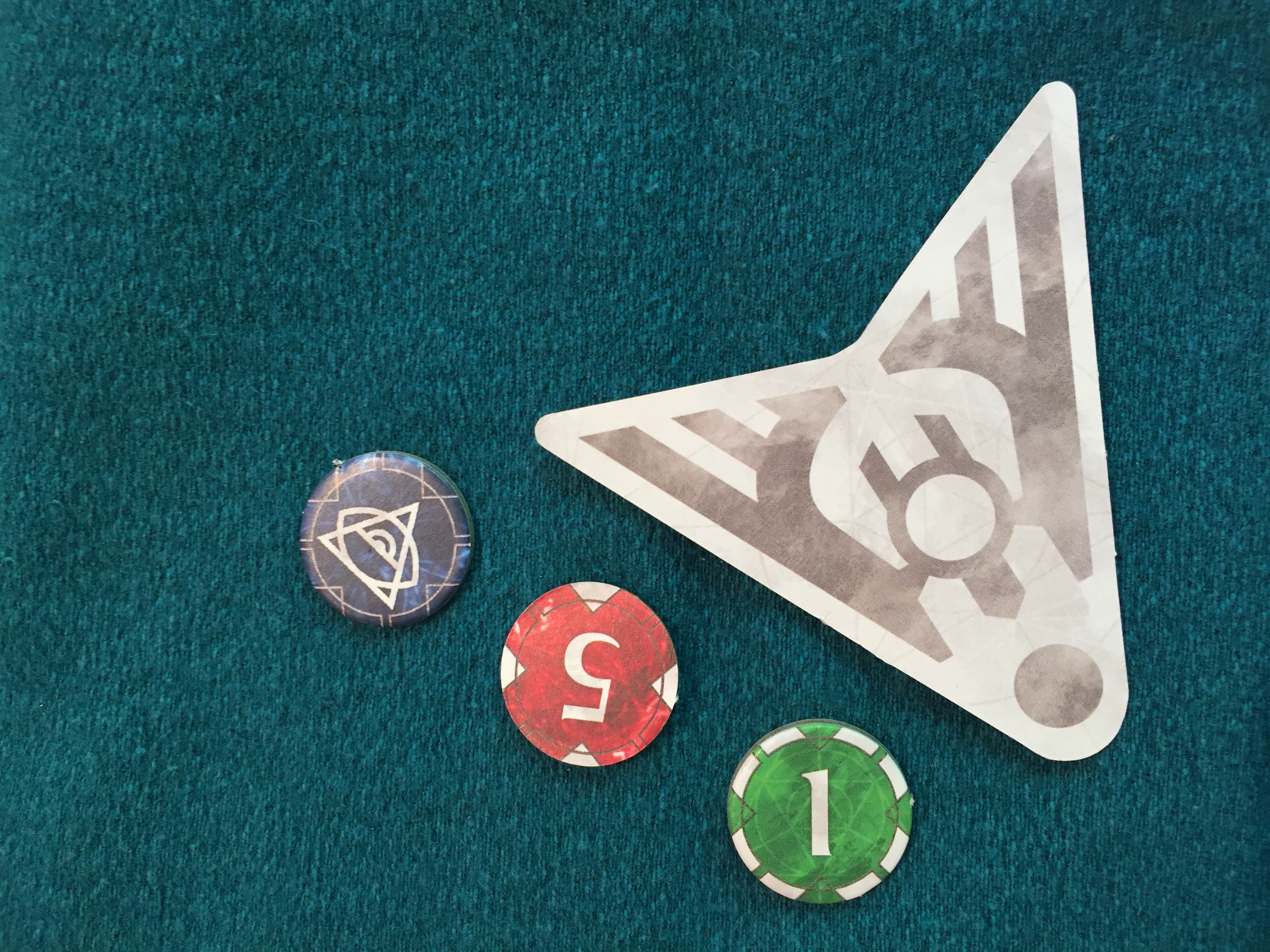 The first player token, and exhaustion, wound/damage and status markers.