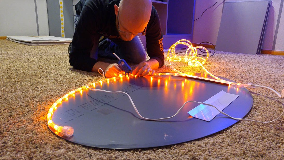 Hot gluing rope lights to the back of a mirror? Almost assuredly a warranty voiding activity, but still pretty freaking sweet.