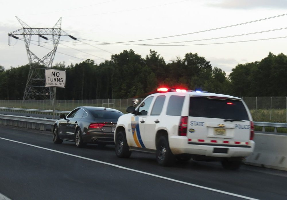 """New Jersey State Police Traffic Stop"" by versageek - http://flickr.com/photos/versageek/7633127888/. Licensed under CC BY-SA 2.0 via Commons - https://commons.wikimedia.org/wiki/File:New_Jersey_State_Police_Traffic_Stop.jpg#/media/File:New_Jersey_State_Police_Traffic_Stop.jpg"