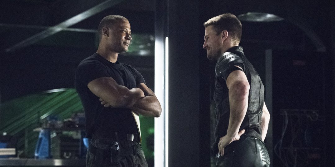 "Arrow -- ""Brotherhood"" -- Image AR407A_0084b.jpg -- Pictured (L-R): David Ramsey as John Diggle and Stephen Amell as Oliver Queen -- Photo: Dean Buscher/The CW -- �© 2015 The CW Network, LLC. All Rights Reserved."