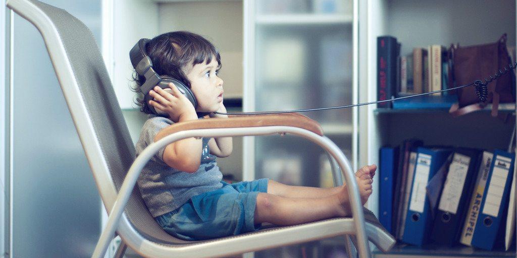 Child listening to headphones