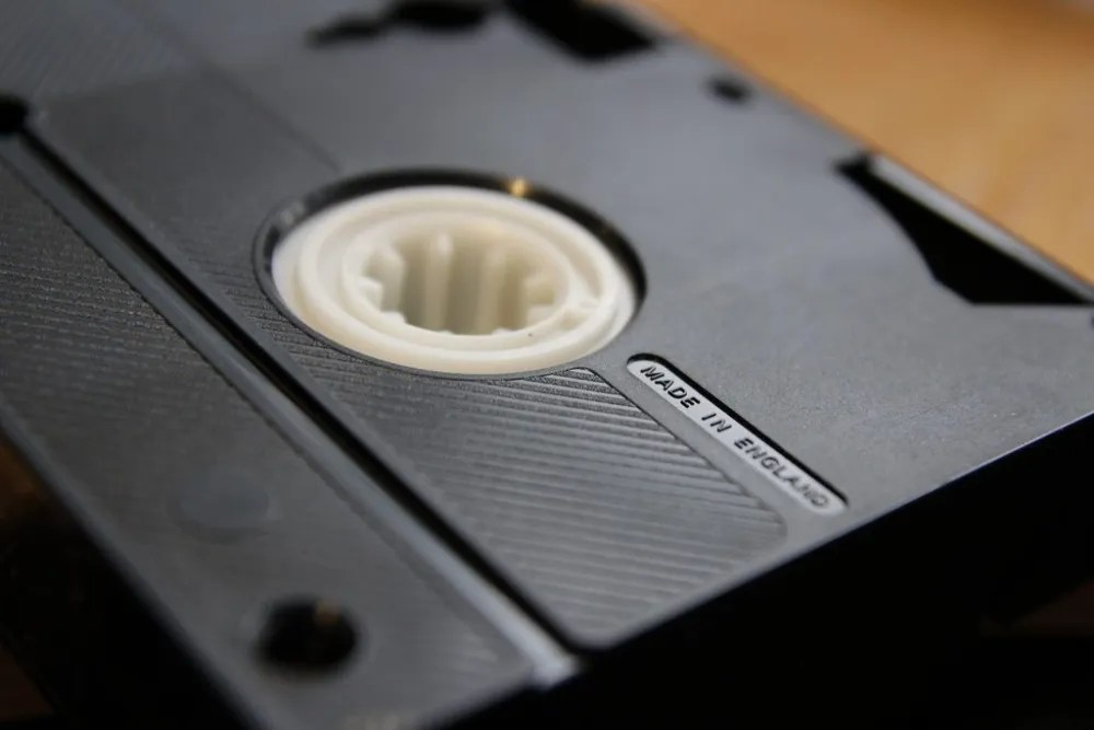 A mainstay throughout the 1980s, video cassettes brought relatively advanced recording technology into the home. (Public domain image from Flickr user comedy_nose).