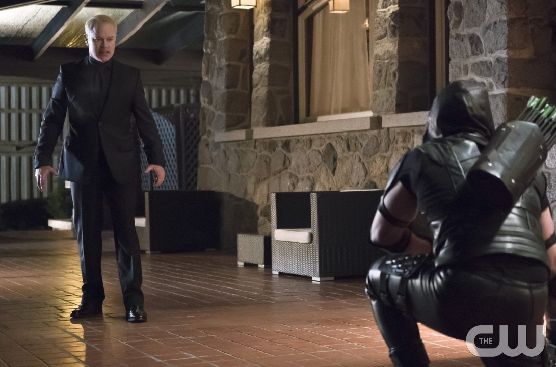 "Arrow -- ""Blood Debts"" -- Image AR410a_0200b.jpg -- Pictured (L-R): Neal McDonough as Damien Darhk and Stephen Amell as The Arrow -- Photo: Katie Yu/ The CW -- �© 2015 The CW Network, LLC. All Rights Reserved."
