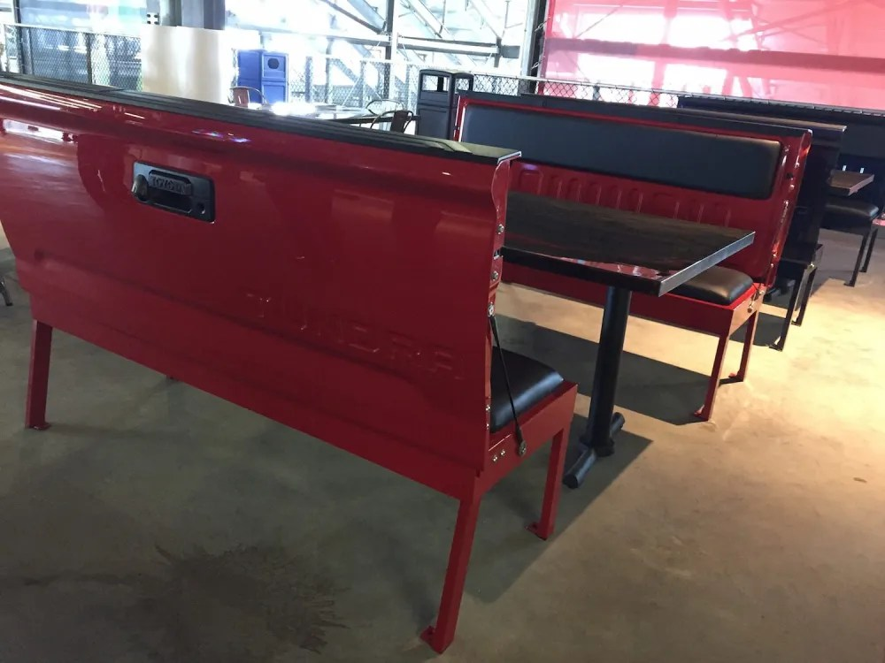 Actual pick-up truck benches at the Toyota Roadhouse. photo by Corrina Lawson