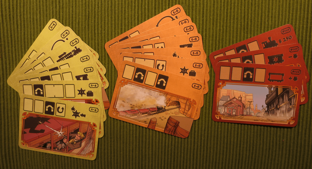 """A round in Colt Express consists of three to five turns, The game is set up by drawing four so-called """"round cards"""" and one """"end-of-game card"""". Each rectangle on the top of such a card represents one turn."""