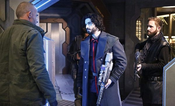 """DC's Legends of Tomorrow -- """"Marooned"""" -- Image LGN107B_0216b.jpg -- Pictured (L-R): Dominic Purcell as Mick Rory / Heat Wave and Aatash Amir as Lieutenant Drake -- Photo: Bettina Strauss/The CW -- �© 2016 The CW Network, LLC. All Rights Reserved."""